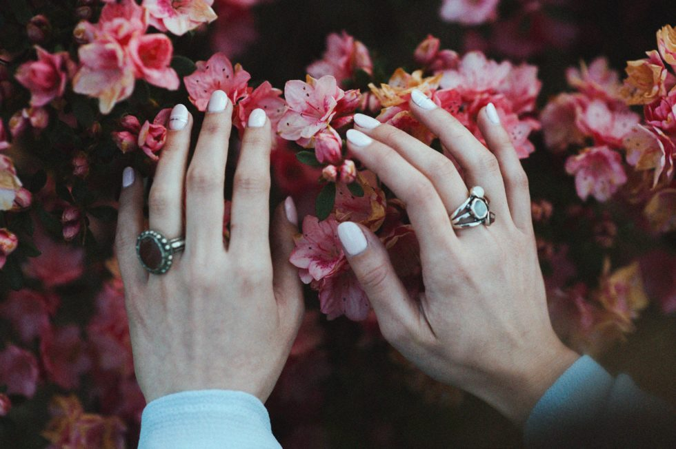 hands on flowers