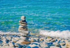stacked stones balancing by water