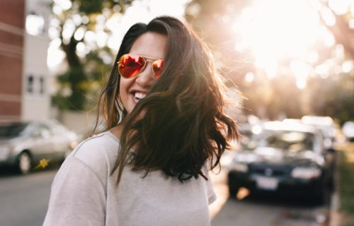 woman smiling in sun
