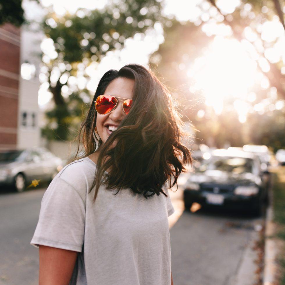 woman smiling in sun